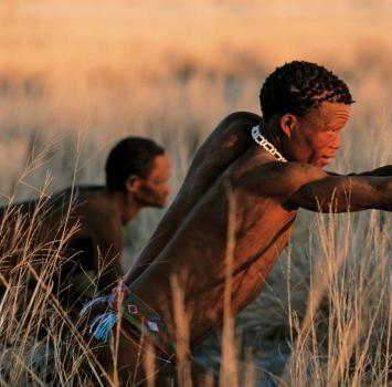 A mosarwa man hunting with son