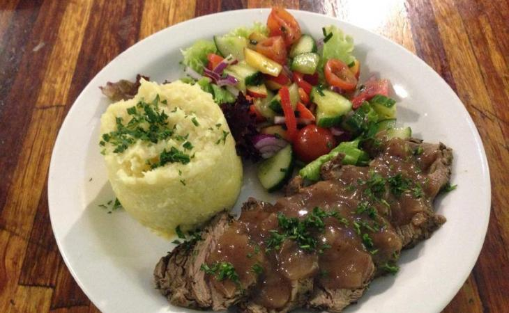 Beef fillet with red wine sauce, served with sweet potato mash and salad