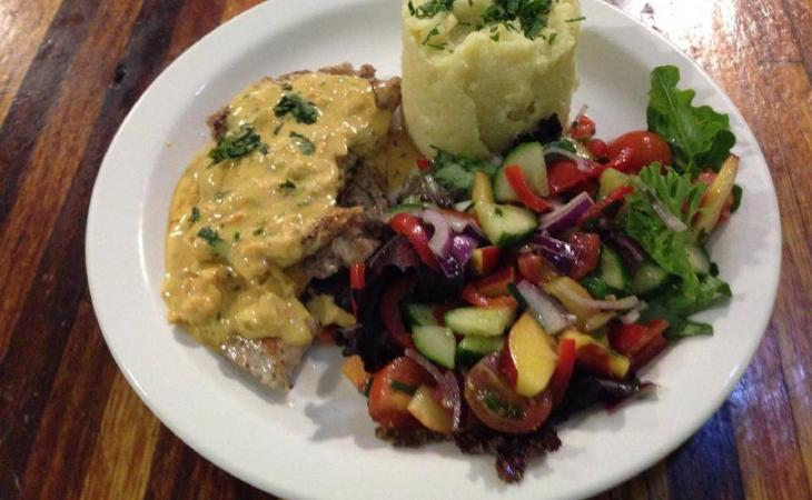Chicken fillet with curry mayonnaise served with sweet potato mash and salad.